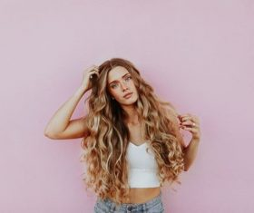 Stock Photo Cute blond girl in front of pink background