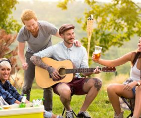 Stock Photo Friends partying man playing guitar 01