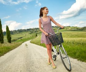 Stock Photo Girl pushing a bicycle on a country road 03