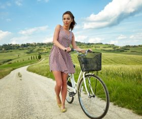 Stock Photo Girl pushing a bicycle on a country road 04