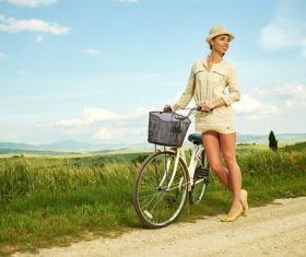 Stock Photo Girl pushing a bicycle on a country road 05