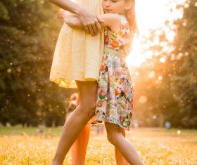 Stock Photo Little girl hugging mother