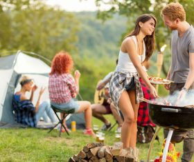 Stock Photo Lovers prepares barbecue for friends at the party 01