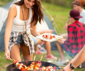 Stock Photo Lovers prepares barbecue for friends at the party 02