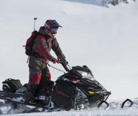 Stock Photo Man driving a snowmobile