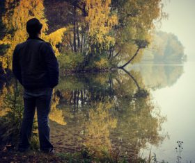 Stock Photo Man standing by the river