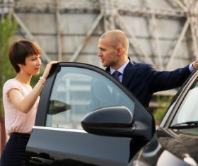 Stock Photo Open the car door for girlfriend