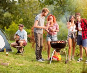 Stock Photo Party friends eating barbecue