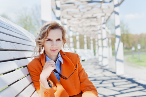 Stock Photo Russian woman sitting on park bench