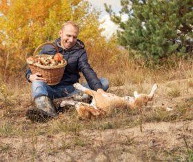 Stock Photo Smiling man and pet dog outdoors