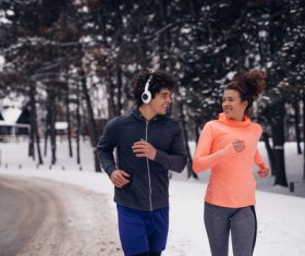 Stock Photo Winter outdoor running lovers