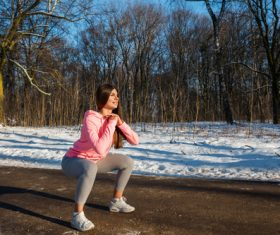 Stock Photo Winter outdoor squat sport girl