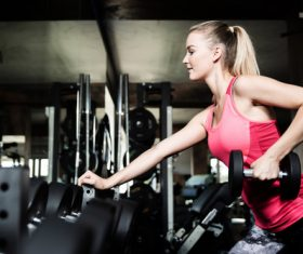 Stock Photo Woman doing body building in gym 01