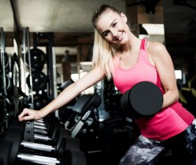Stock Photo Woman doing body building in gym 03