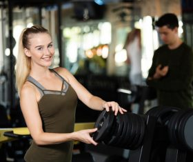 Stock Photo Woman doing body building in gym 05