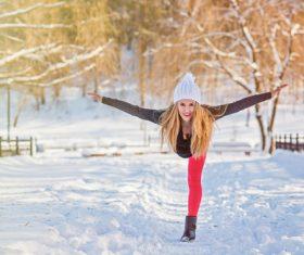 Stock Photo Woman posing on the snow