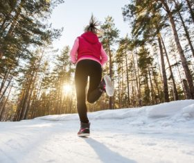 Stock Photo Woman running on the snow