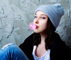 Stock Photo Young girl blowing Bubble Gum 01