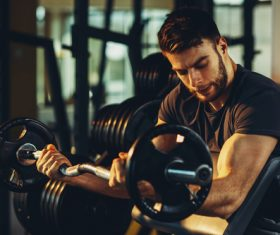 Stock Photo Young male exercising biceps 01