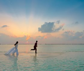 Sunset seaside beautiful wedding photos Stock Photo