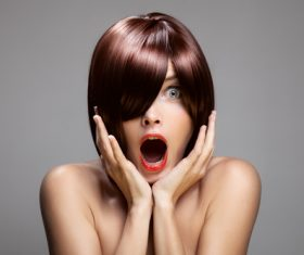 Surprised open mouth red hair woman Stock Photo