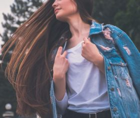 Swinging hair jeans woman Stock Photo