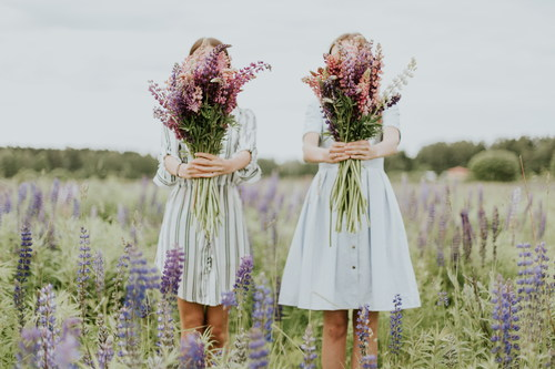 Two girls holding bouquets Stock Photo
