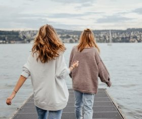 Two girls watching the sea Stock Photo