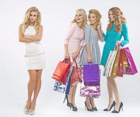 Unhappy woman and shopping women Stock Photo 01