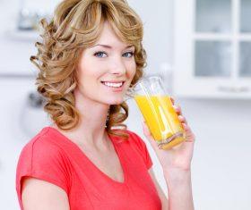 Woman drinking juice Stock Photo