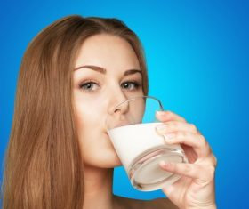 Woman drinking milk Stock Photo 02