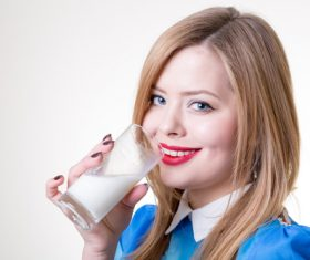 Woman drinking milk Stock Photo 04