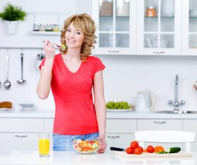 Woman eating vegetable salad Stock Photo 02