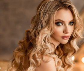 Woman golden big wavy curly hair Stock Photo
