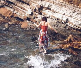 Woman playing with water by the river outdoors Stock Photo