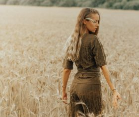 Woman posing in the wheat field Stock Photo