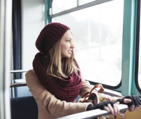 Woman sitting in the tram looks out the window Stock Photo
