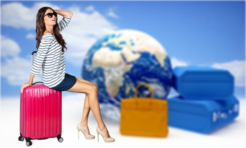 Woman sitting on travel suitcase resting Stock Photo