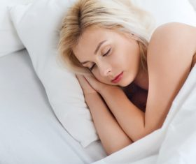 Woman taking a nap Stock Photo 01