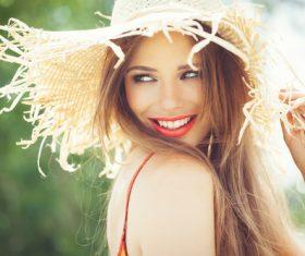 Woman wearing a sunshade straw hat Stock Photo
