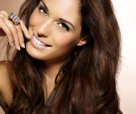 Woman wearing diamond ring smiling Stock Photo