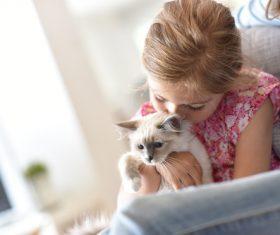 Woman with kitten on lap Stock Photo 02