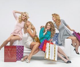 Women holding shopping bags sitting on the couch Stock Photo 03