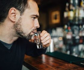 Young man drinking at the bar Stock Photo 01