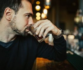 Young man drinking at the bar Stock Photo 02