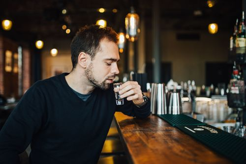 Young man drinking at the bar Stock Photo 03