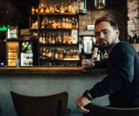 Young man drinking at the bar Stock Photo 04