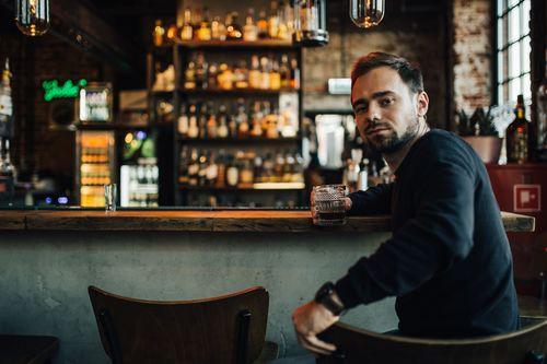 Young man drinking at the bar Stock Photo 04