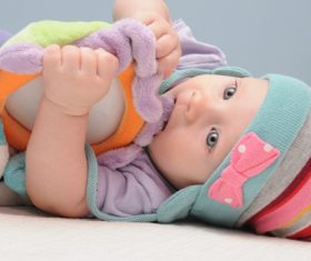 Baby biting a toy Stock Photo 03