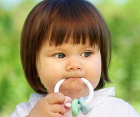 Baby biting a toy Stock Photo 04